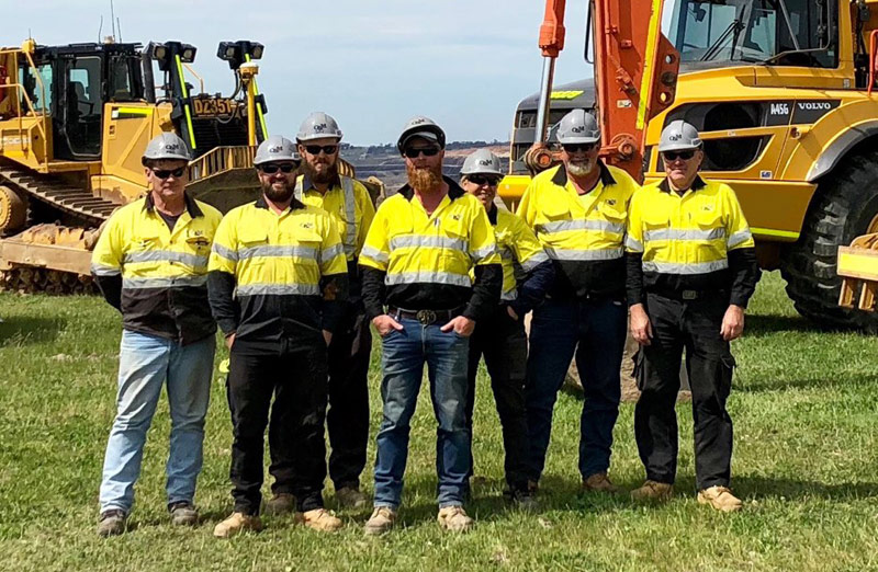 O&M staff with earthworks machinery